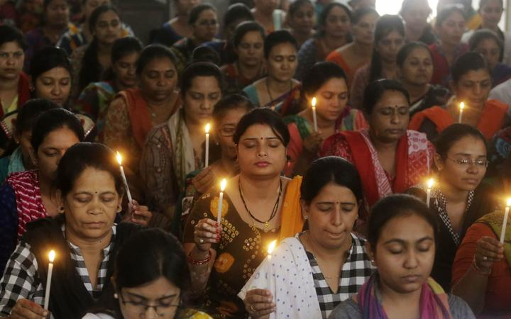 Indian staff at a school pray for the victims of Sunday's blasts in Sri Lanka, in Ahmadabad, India, Monday, April 22, 2019.
