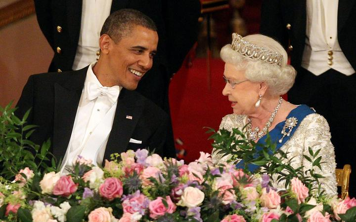 Former US President Barack Obama speaks with Britain's Queen Elizabeth II at Buckingham Palace, in London