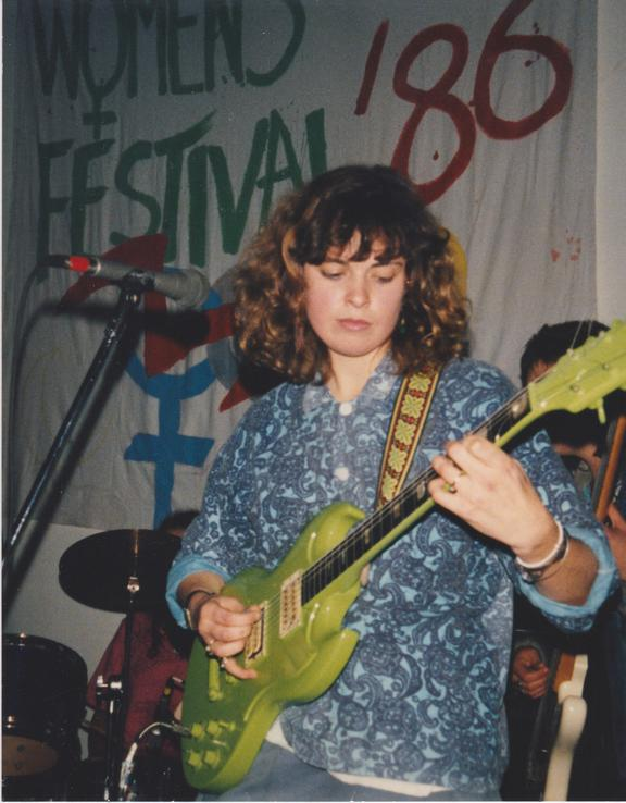 Jan Hellriegel performing at a Women's Festival in1986.