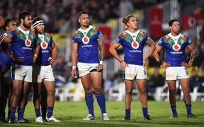 Peta Hiku, Jazz Tevaga, Ken Maumalo, Chanel Harris-Tavita and Gerard Beale watch the replay scoreboard screen during the Warriors match against the North Queensland Cowboys on Saturday.