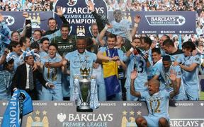 Manchester City celebrate winning the 2011-12 EPL title.