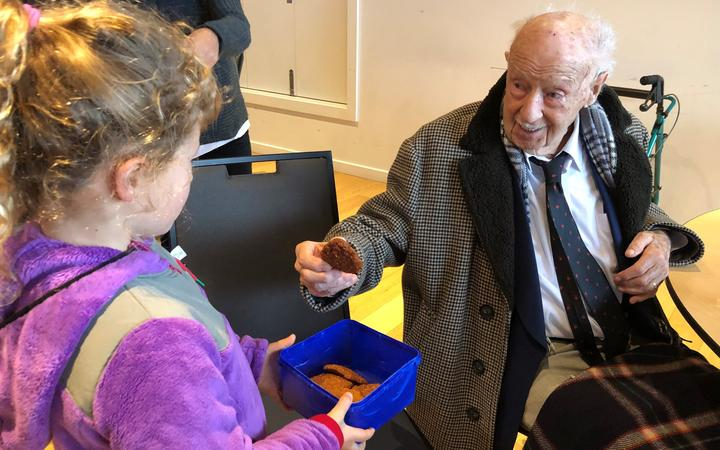 Madison Webb baked Anzac biscuits for veterans at the RSA in Christchurch.