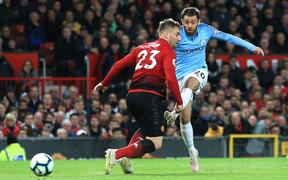 Manchester City's Bernardo Silva scores against Manchester United at Old Trafford.