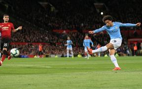 Leroy Sane adds a second for City in the Manchester derby.