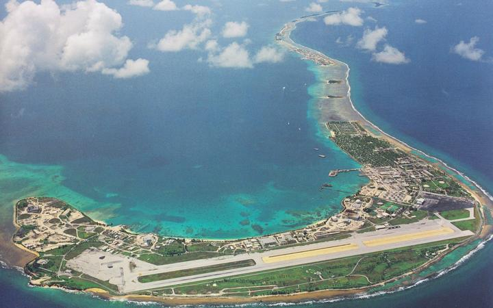 An aerial view of the southern portion of Kwajalein Atoll, with the US Army base island at Kwajalein visible in the foreground with runway, and Ebeye, home of the two missing fishermen, the third island on the right side along the eastern reef of the atoll.