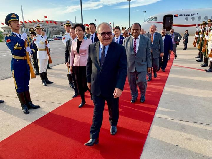 Papua New Guinea's prime minister Peter O'Neill arrives in Beijing for a 'Belt and Road' summit, 25 April 2019.
