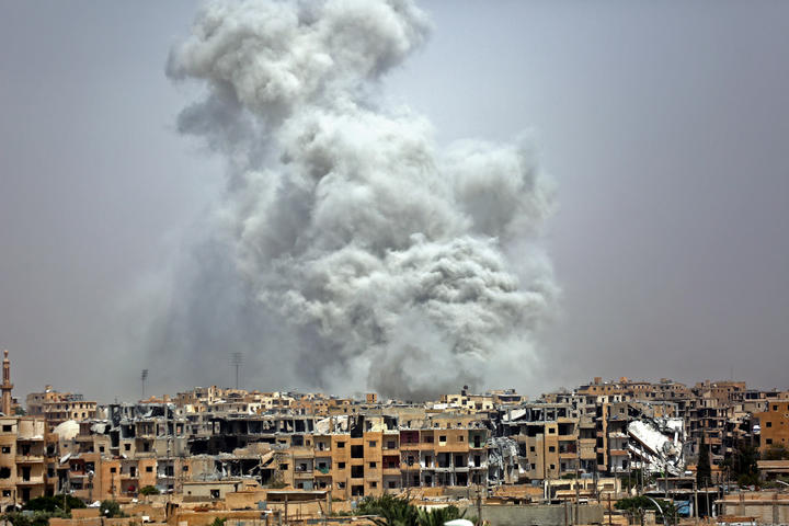 Smoke billows out from Raqqa following a US-led coalition air strike.