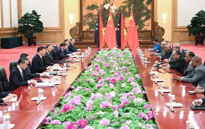 Chinese President Xi Jinping and officials meet with Papua New Guinea's Prime Minister Peter O'Neill and ministerial colleagues in Beijing, April 25, 2019.