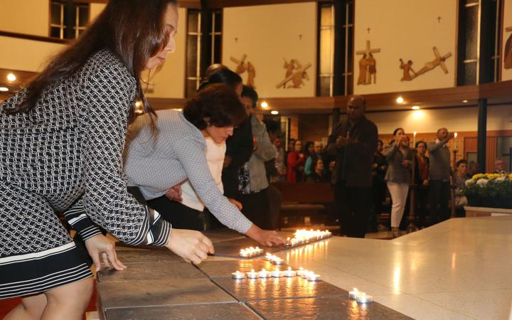 People lit candles at a special service in Auckland's Northcote to remember the victims.