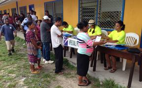 Marshall Islanders line up to vote at a Majuro elementary school during the 2015 national election.