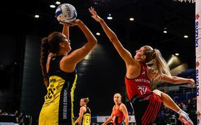 Aliyah Dunn of the Pulse shoots over Jane Watson of the Tactix.