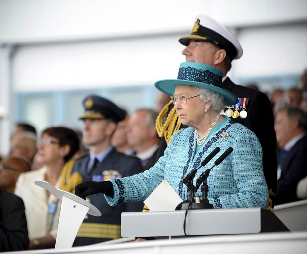 Queen Elizabeth naming the aircraft carrier at Rosyth Dockyard in Scotland.