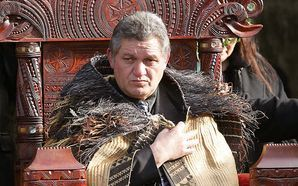 Maori King Tuheitia Paki sitting on the carved wooden throne  at Turangawaewae Marae in Ngaruawahia.
