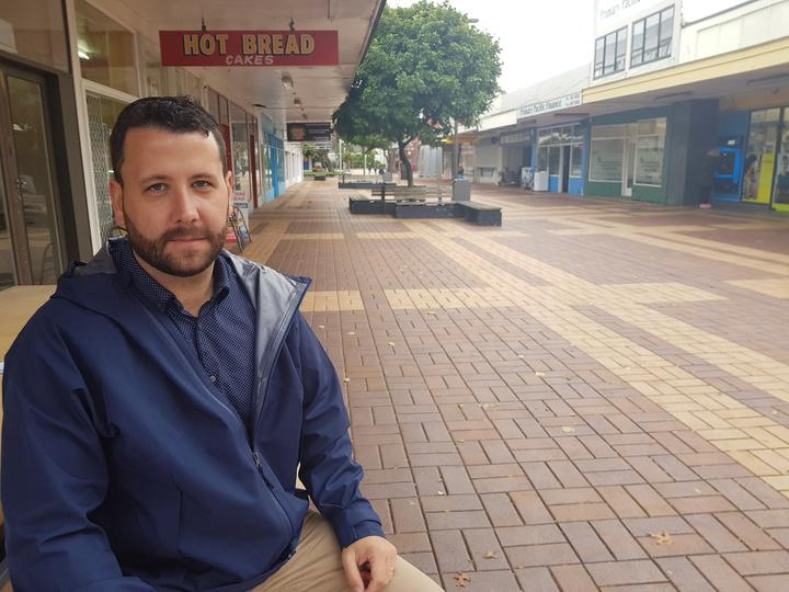 Hutt City Councillor Campbell Barry with an empty shopping centre in the background.