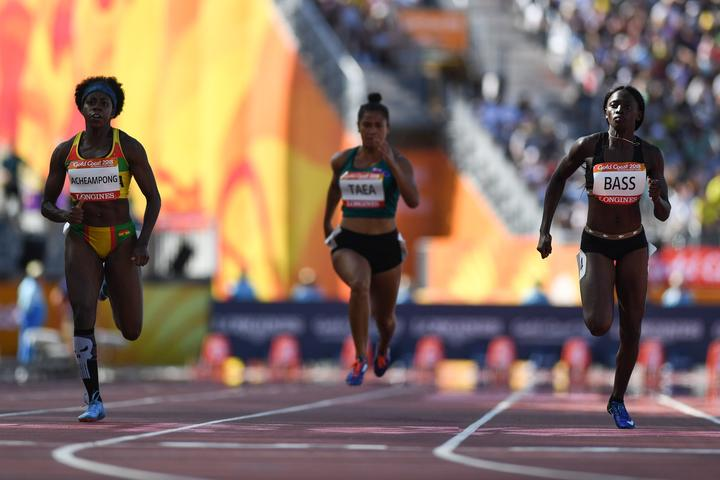 Patricia Taea (c) competes in the women's 100m heats during the 2018 Gold Coast Commonwealth Games.