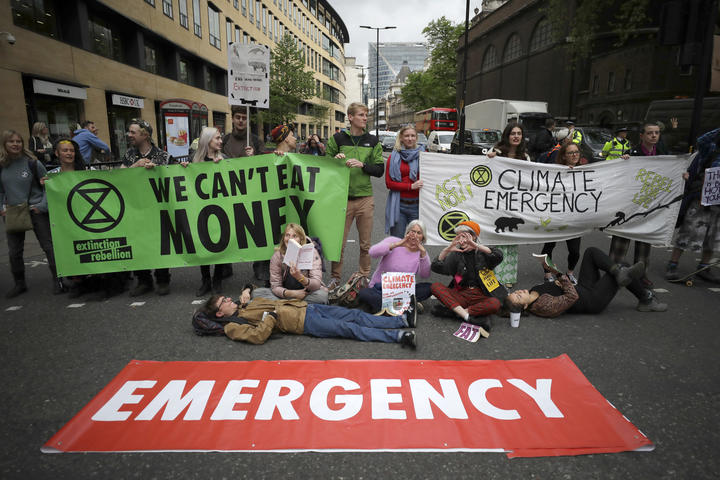 Extinction Rebellion climate change protesters briefly block the road in London, on 25 April, 2019.