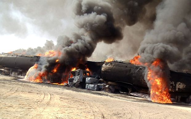 Road tankers burn in an earlier Taliban attack.