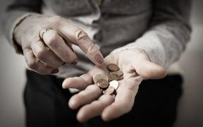 72222257 - older person counting money in her palm