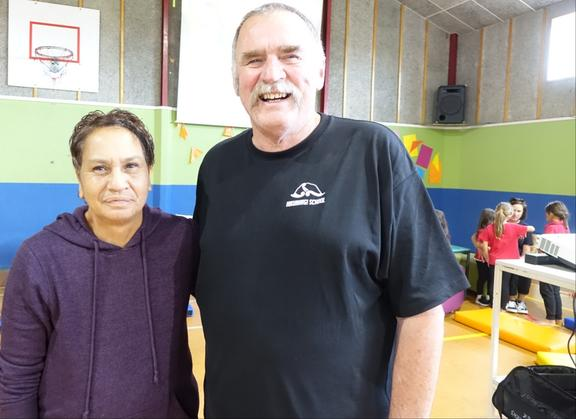 Hikurangi principal Bruce Crawford  with Shona Whitehead who led the fundraising drive for meinigitis vaccinations for Northland kids .