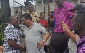 Felix Anthony is greeted by media and his supporters upon his release.