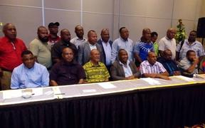 The MPs who have defected from the government of Prime Minister Peter O'Neill include several senior ministers. They held in a news conference in Port Moresby on Friday.