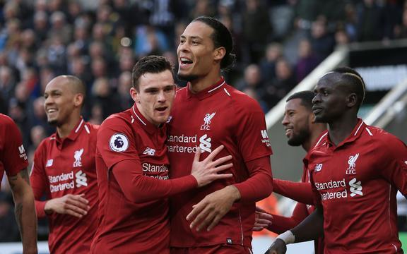 Virgil van Dijk of Liverpool celebrates with his team-mates.