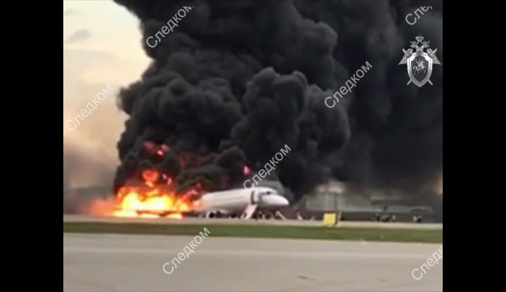 In this photo released by Russian Investigative Committee the Sukhoi Superjet 100 passenger plane of Russian Aeroflot Airlines is on fire at the Moscow's Sheremetyevo International Airport, Russia.