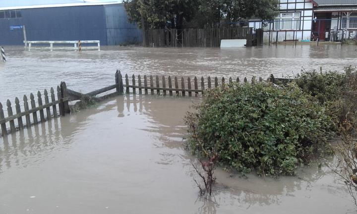 Flooding at the Lamberts' front fence.