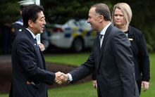 Shinzo Abe shakes hands with New  John Key at Government House in Auckland.