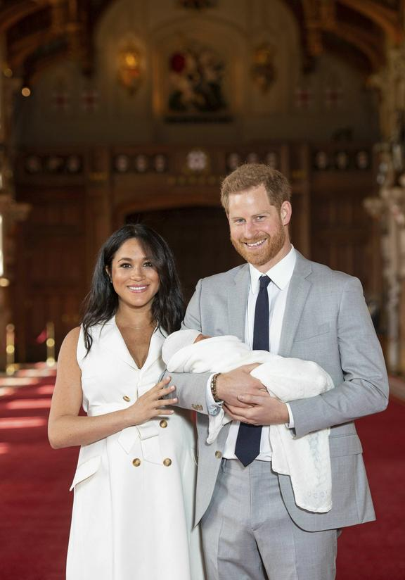 Britain's Prince Harry and Meghan, Duchess of Sussex, during a photocall with their newborn son, in St George's Hall at Windsor Castle, Windsor, south England, Wednesday May 8, 2019.