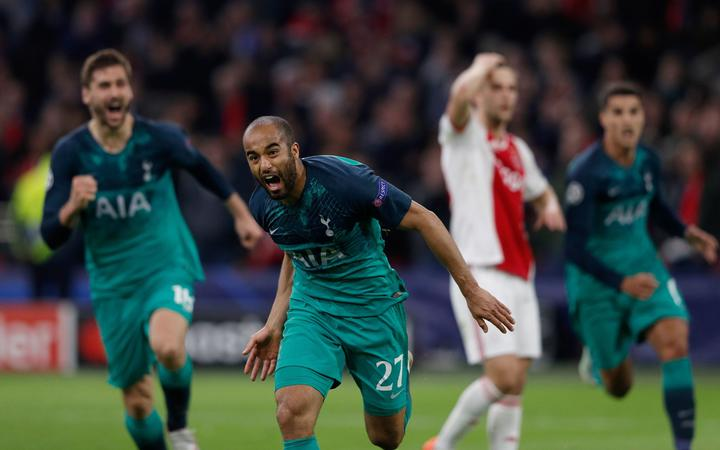 Tottenham's Brazilian forward Lucas celebrates after scoring a goal during the UEFA Champions League semi-final second leg football match against Ajax Amsterdam.
