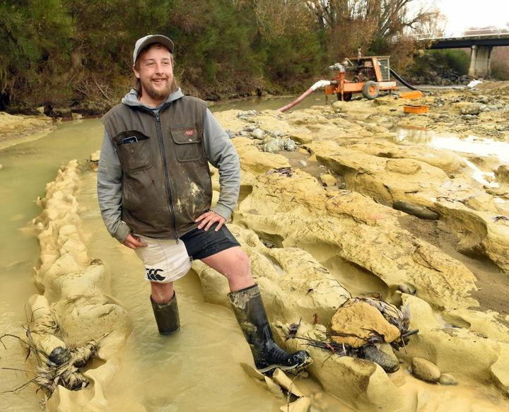 Michael Johnston at the riverbed site where preparations are being made to remove the the fossilised moa footprints he discovered .