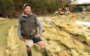 Michael Johnston at the riverbed site where preparations are being made to remove the the fossilised moa footprints he discovered.