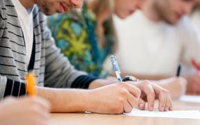 21790139 - writing hands of students at course