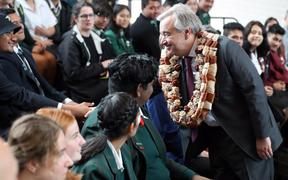 United Nations Secretary-General Antonio Guterres (R) meets students after giving a speech at the Auckland University of Technology (AUT) South Campus