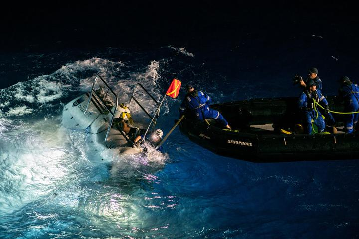 The submersible DSV Limiting Factor being recovered after its first dive to the deepest point of the Challenger Deep