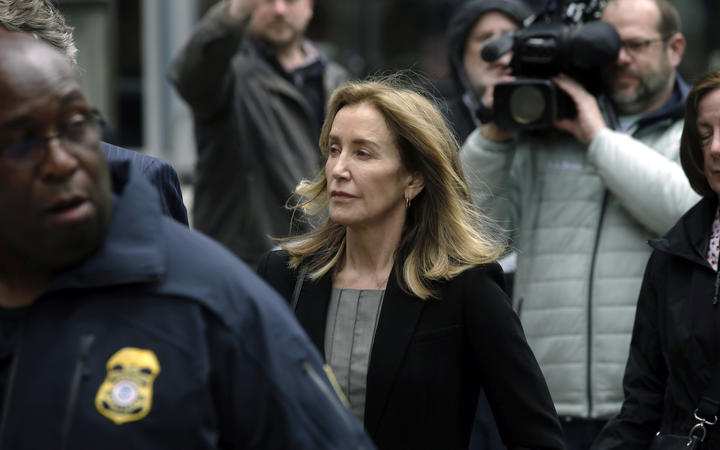 Felicity Huffman arrives at federal court in Boston, 13 May 2019.