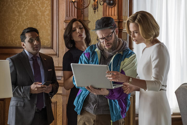 Tom (Ravi Patel), Maggie (June Diane Raphael), Fred Flarsky (Seth Rogen), and Charlotte Fields (Charlize Theron) in Long Shot.