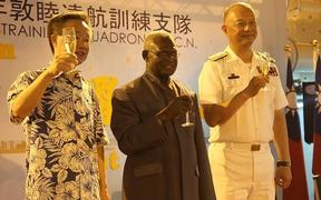 Taiwan Ambassador to Solomon Islands H.E Roger Luo, Prime Minister Manasseh Sogavare, and Commander Rear-Admiral Wang Cheng-chung up for the toast.