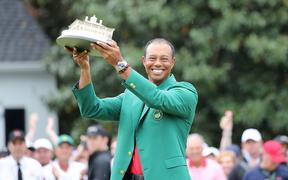 Tiger Woods celebrates with the trophy and Green Jacket during the award ceremony of the 2019 Masters.