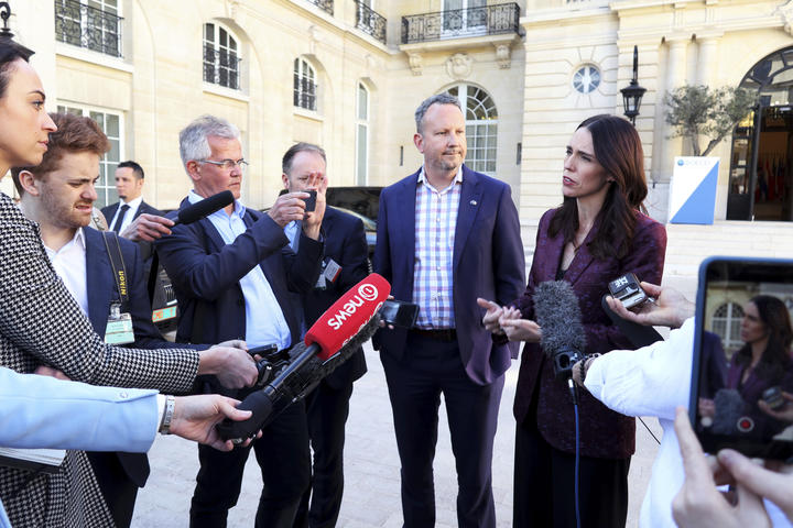 Prime Minister Jacinda Ardern, right, and InternetNZ chief executive Jordan Carter, who chaired the Voices for Action meeting, speak to media in Paris.