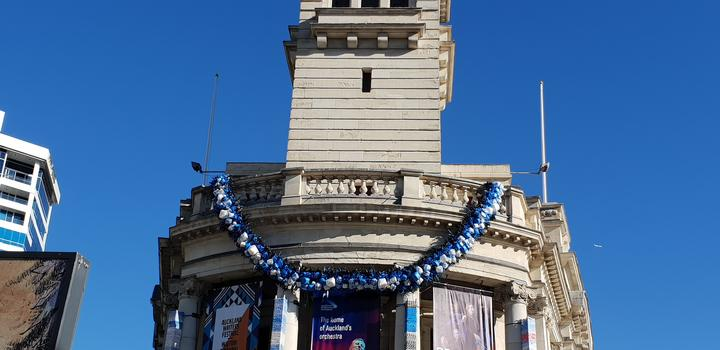 The Ei hangs on the Auckland Town Hall clock tower.