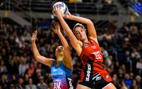 Ellie Bird of the Tactix fights Courtney Elliott of the Steel for the ball.