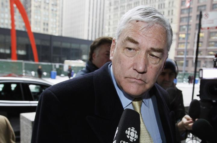 FILE - In this Jan. 13, 2011 file photo, Conrad Black arrives at the federal building in Chicago. President Donald Trump has granted a full pardon to Black, a former newspaper publisher who has written a flattering political biography of Trump.