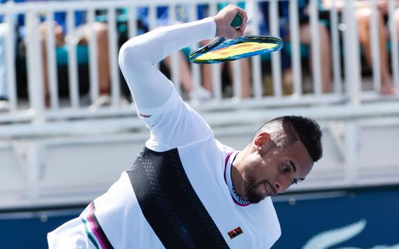Australian tennis player Nick Kyrgios throws his racquet.