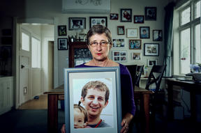 Kelly Savage's mother, Martha Savage holds a picture of her son. Kelly Savage died in in Japan after being restrained in a bed of a psychiatric hospital for 10 days.