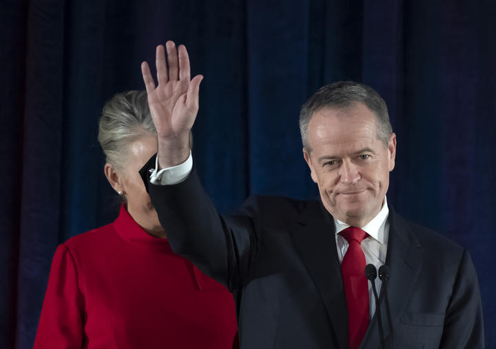 Australian Labor leader Bill Shorten gestures on stage with his wife Chloe, at the Federal Labor Reception in Melbourne, Australia after conceding defeat to Prime Minister Scott Morrison in the country's general election.
