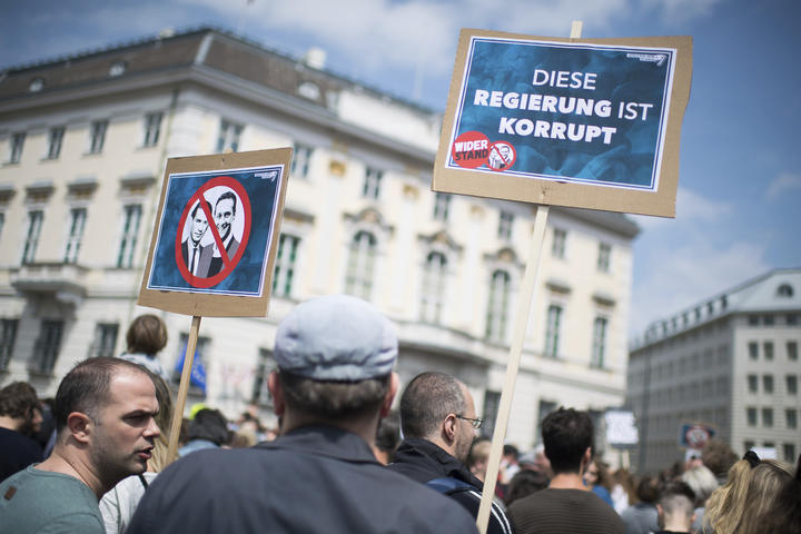 Demonstrators gather in front of the Austrian Chancellors Office in Vienna, Austria, Saturday, May 18, 2019. Slogan reads: 'This Government Is Corrupt'.
