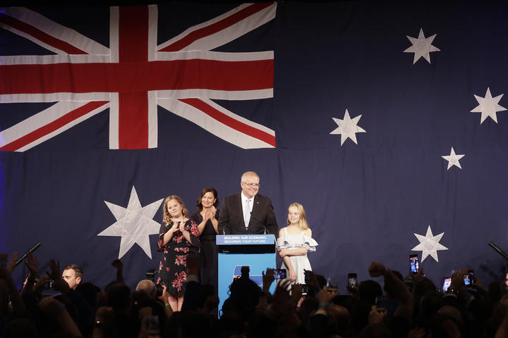Australian Prime Minister Scott Morrison arrives to speak to party supporters flanked by his wife Jenny, and daughters Abbey, left, and Lily after his opponent Bill Shorten conceded defeat in the federal election.
