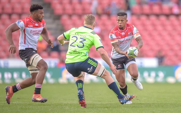 The Highlanders' Waisake Naholo and The Emirates Lions' Elton Jantjies during the 2019 Super Rugby match between the Emirates Lions and the Highlanders at the Ellis Park Stadium, Johannesburg on the 18 May 2019 